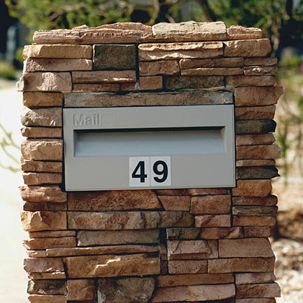 letterbox within a brick wall